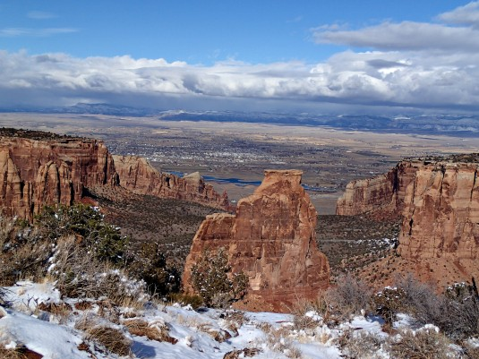 Taken from the Colorado National Monument, with Independence Monument in the foreground and the Grand Valley beyond.