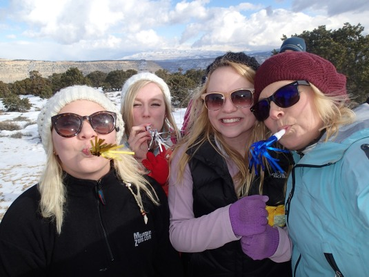 Making some noise on the summit with my daughters.